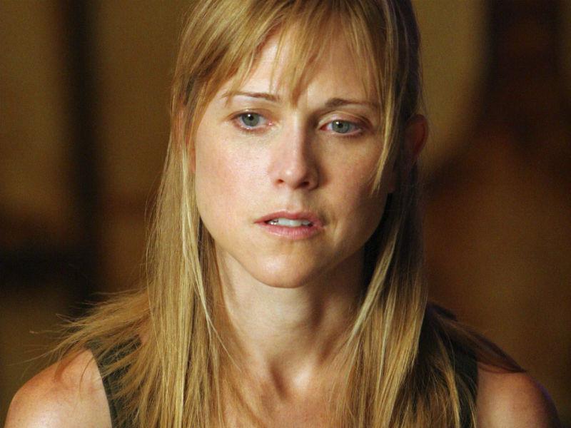 Tracy Middendorf como Margaret 'Maggie' Duvall